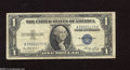 "Error Notes:Skewed Reverse Printing, Fr. 1614 $1 1935E Silver Certificate. Fine. This note has a hugeskewed back print that shows more than 1/4"" margin on the ..."