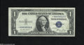 Error Notes:Major Errors, Fr. 1614* $1 1935E Silver Certificate Star. Extremely Fine-AboutUncirculated. This note exhibits a paper defect as an as m...