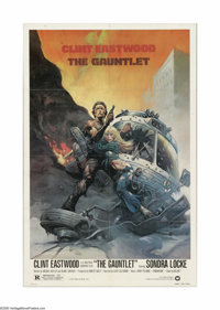 """The Gauntlet (Warner Brothers, 1977). One Sheet (27"""" X 41""""). Offered here is a vintage, theater-used poster fo..."""