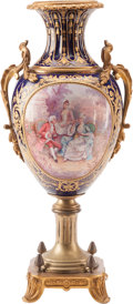 Decorative Arts, Continental, A Sevres-Style Porcelain and Gilt Bronze Urn. 23-1/2 h x 11-1/2 w x9 d inches (59.7 x 29.2 x 22.9 cm). ...