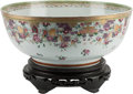 Asian:Chinese, A Chinese Export-Style Partial Gilt Porcelain Punch Bowl onHardwood Stand. 7 h x 16 w x 16 d inches (17.8 x 40.6 x 40.6 cm)...(Total: 2 Items)