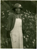 Photography:Signed, Doris Ulmann Signed Platinum Print. A 3/4 length portrait of awoman standing by a field of daisies. She is wearing a hat, a...