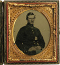 Photography:Ambrotypes, Cased 1/6th Plate Ruby Ambrotype of a Union Soldier. A seated Federal infantryman is shown in a regulation frock coat having...