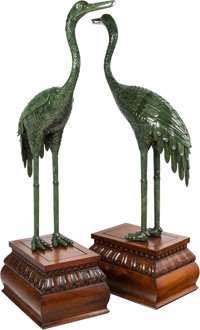 A Monumental Pair of Chinese Carved and Veneered Spinach Jade Cranes on Wooden Stands 79-1/2 inches high (201.9 cm