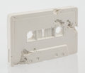 Sculpture, Daniel Arsham (American, b. 1980). Cassette Tape (FR-04), 2015. Plaster with glass fragments. 2-5/8 x 4 x 1 inches (6.7 ...