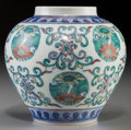 Asian:Chinese, A Chinese Doucai Porcelain Jar, Qing Dynasty, 18th-19th century.Marks: Six-character Yongzheng mark in underglaze blue and ...