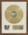 "Music Memorabilia:Awards, Beatles ""Abbey Road"" Gold Sales Award. The plaque on this whitematte-style award reads: ""Presented to Apple Records to comm..."