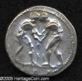 Ancients:Greek, Ancients: Pamphylia, Aspendos. Ca. 380-325 B.C. AR stater (23 mm,10.70 g). Two wrestlers grappling; KI between / Slinger right;trisk...