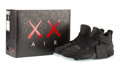 Fine Art - Sculpture, American:Contemporary (1950 to present), KAWS X Nike. Air Jordan 4, 2017. Black sneakers with glow inthe dark soles, size 10.5. 6-3/4 x 12 x 3-1/2 inches (17.2 ...