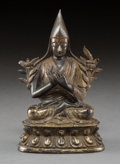 Asian:Chinese, A Tibetan Gilt Bronze Seated Lama, 18th century. 6-3/4 h x 4-1/4 wx 3 d inches (17.1 x 10.8 x 7.6 cm). ...