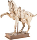 Asian, A Chinese Tang-Style Pottery Horse. 22 inches high (55.8 cm)...