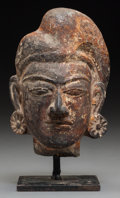 Asian:Chinese, An Indian Terracotta Head, Possibly Gupta Period. 6-1/2 inches high(16.5 cm) (including stand). ...