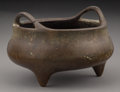 Asian:Chinese, A Chinese Bronze Censer. Marks: Six-character Xuande mark and of alater period. 3 inches high x 4-1/2 inches diameter (7.6 ...
