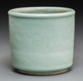 Asian:Chinese, A Chinese Celadon Porcelain Brush Pot with Incised FloralDecoration, Qing Dynasty, 18th-19th century. 4-5/8 inches high x5...