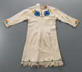 American Indian Art:Beadwork and Quillwork, A Blackfoot or Flathead Girl's Beaded Hide Dress . c. 1930...