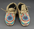 American Indian Art:Beadwork and Quillwork, A Pair of Plains Beaded Hide Moccasins Lengths...