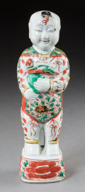 Asian:Chinese, A Chinese Porcelain He Figure Holding Flowerpot, Qing Dynasty,Kangxi Period, circa 1662-1722. 10-3/8 inches high (26.4 cm)...