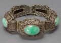 Asian:Chinese, A Chinese Jadeite and Silver Filigree Bangle, early RepublicPeriod. Marks: SILVER. 3 inches diameter (7.6 cm). ...