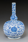 Asian:Chinese, A Chinese Blue and White Porcelain Double-Gourd Bottle Vase, QingDynasty. 15 inches high (38.1 cm). ...
