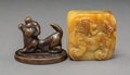 Asian, Two Chinese Hardstone and Bronze Foo Dog Seals. 1-3/4 inches high(4.4 cm) (taller, bronze). ... (Total: 2 Items)