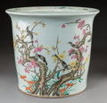 Asian:Chinese, A Chinese Enameled Porcelain Magpie and Prunus Planter, QingDynasty. Marks: Four-character Qianlong mark and of a later per...