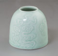 Asian:Chinese, A Chinese Celadon Glazed Water Pot with Cloud Motif, Qing Dynasty,19th century. Marks: Six-character Kangxi mark and of a l...