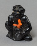 Asian:Japanese, A Japanese Carved Ebony and Coral Islander Netsuke, Meiji Period,late 19th century. 1-1/2 inches high (3.8 cm). ...
