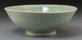 Asian:Chinese, A Chinese Celadon Glazed Porcelain Bowl, early Qing Dynasty, 17thcentury. 3-1/2 inches high x 9-1/2 inches diameter (8.9 x ...