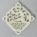 Asian:Chinese, A Chinese Carved Pale Jade Reticulated Pendant. 1-3/4 inches high x1-3/4 inches wide (4.4 x 4.4 cm). ...