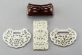 Asian:Chinese, Three Chinese Carved White Jade Reticulated Plaques, Qing Dynasty.3 inches long (7.6 cm) (longest). ... (Total: 3 Items)