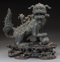 Asian:Chinese, A Chinese Bronze Foo Lion Censer on Rosewood Stand, Qing Dynasty.18-1/2 h x 17-1/2 w x 10 d inches (47.0 x 44.5 x 25.4 cm) ...