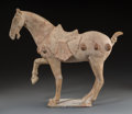 Asian:Chinese, A Chinese Tang Pottery Horse, Tang Dynasty, circa 618-907. 16-1/2 hx 17-3/4 w x 7-1/2 d inches (41.9 x 45.1 x 19.1 cm). ...
