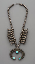 American Indian Art:Jewelry and Silverwork, A Navajo Squash Blossom Necklace. c. 1930. ...