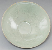 A Korean Celadon Glazed Bowl with Incised Foliate Decoration 2-7/8 inches high x 8 inches diameter (7.3 x 20.3 cm)