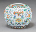 Asian:Chinese, A Diminutive Chinese Doucai Porcelain Jar, late Qing-early RepublicPeriod. Marks: Six-character Qianlong mark. 2-1/8 inches...