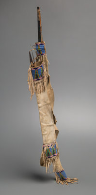 A Sioux Buffalo Hide Bow Case and Quiver c. 1870