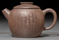 Asian:Chinese, A Chinese Yixing Pottery Teapot with Incised Heart Sutra, QingDynasty, 19th century. 2-1/2 inches high (6.4 cm). ...
