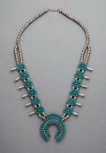 Jewelry:Necklaces, A Zuni Reversible Squash Blossom Necklace. c. 1995. ...
