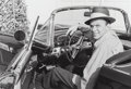 Photographs, Frank Worth (American, 1923-2000). Frank Sinatra in His T-Bird, 1955. Gelatin silver, printed later. 12-7/8 x 18-3/4 inc...