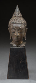 Asian, A Southeast Asian Bronze Buddha Head on Stand. 4-1/2 inches high(11.4 cm) (head). 8-1/8 inches high (20.6 cm) (overall). ...