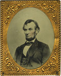 Photography:Tintypes, Abraham Lincoln: Large Tintype in Brass Frame. This tintype wasmade from an engraving done of the original photograph by A....