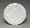 Asian:Chinese, A Chinese Carved White Jade Disc with Dragon. 2 inches diameter(5.1 cm). ...