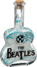 Music Memorabilia:Memorabilia, Beatles Glass Guitar-Shaped Bubble Bath Container, Circa 1980s....