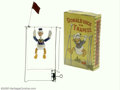 Memorabilia:Miscellaneous, Donald Duck on Trapeze Toy with Box (Geo. Borgfeldt Corp., 1930s). The desirability and collectibility of early Disney chara...