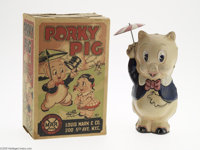 "Porky Pig Toy with Umbrella and Box (Marx, 1939). This impressive tin litho toy with built-in key is 3""x 5""x 8..."