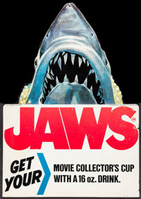 """Jaws (7-Eleven Incorporated, 1975). Promotional Display (11"""" X 15.5"""") DS, & Special Edition Vinyl Cup (16..."""