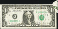 Error Notes:Attached Tabs, Butterfly Fold Error Fr. 1913-E $1 1985 Federal Reserve Note. VeryFine.. ...