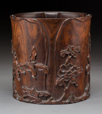 A Fine Chinese Carved Hardwood Bitong Brush Pot, Qing Dynasty, 18th century 6-3/8 inches high x 6-1/4 inches diame