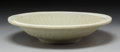 Asian:Chinese, A Chinese Celadon Glazed Earthenware Basin, Ming Dynasty, circa1368-1644. 3 inches high x 13 inches diameter (7.6 ...