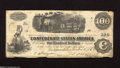 Confederate Notes:1862 Issues, T40 $100 1862. This popular locomotive issue has good color, butshows some foxing and pinholes. Fine....